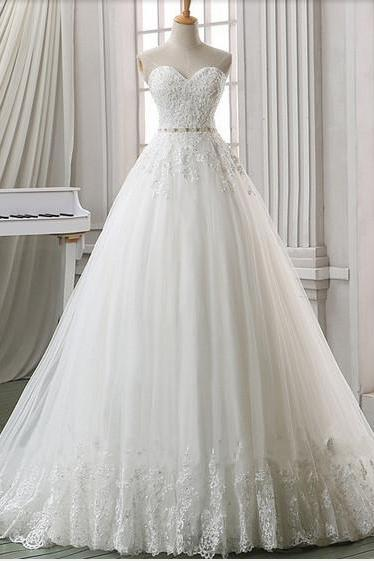 Lace Appliqués Sweetheart Floor Length Tulle Wedding Gown Featuring Chapel Train